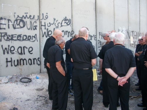 Bishops gather at the Separation Wall in Jerusalem.