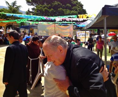 Bishop Pates meets with community members during a meeting in Guatemala on the effects of mining.