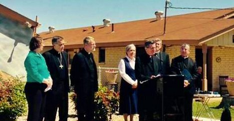 Archbishop Garcia-Siller calls for an end to immigrant family detention during a press conference in Dilley, Texas.
