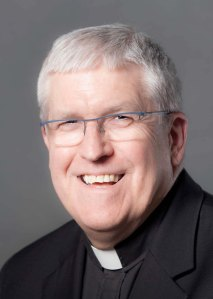 headshot of Fr. John Crossin