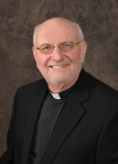 headshot of Fr. John Rausch