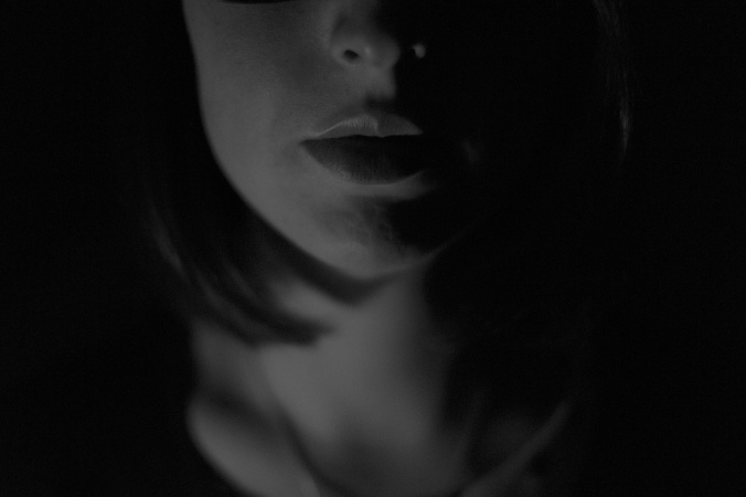 woman's face and neck in shadows