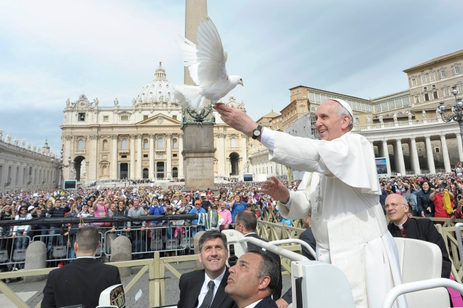 Pope Francis holds dove before his weekly audience at the Vatican