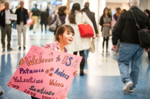 A young girl waits at the airport to greet an arriving refugee familiy. She is participating with her family in the local POWR program at Catholic Charities in Jacksonville, Fla. (Photo by , Sarah Williamson in Jacksonville, Florida)