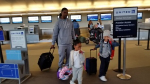 Dominic and his children get their boarding passes for Rome