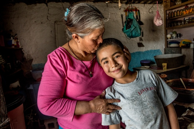 Maria de lu Luz Lego Martinez, here with her grandson Alexis. runs a household without a husband, who went to the US. Of her 10 children, four have died, two live in the United States, and the other four live nearby. Photo by Karen Kasmauski for Catholic Relief Services.