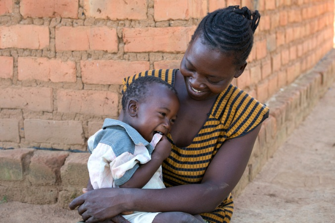 Evelina Banda, 35 years old, with her son, Steven, 16 months old, in Ndombi Village, Zambia. Photo by Jim Stipe/Catholic Relief Services