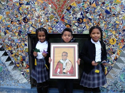 Sacred Heart School--photo of students with St. Romero and cranes - TGF use ONLY